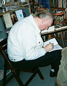 artist William F. Nolan creating inscription