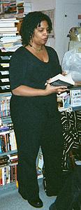 Nalo Hopkinson selecting a passage to read